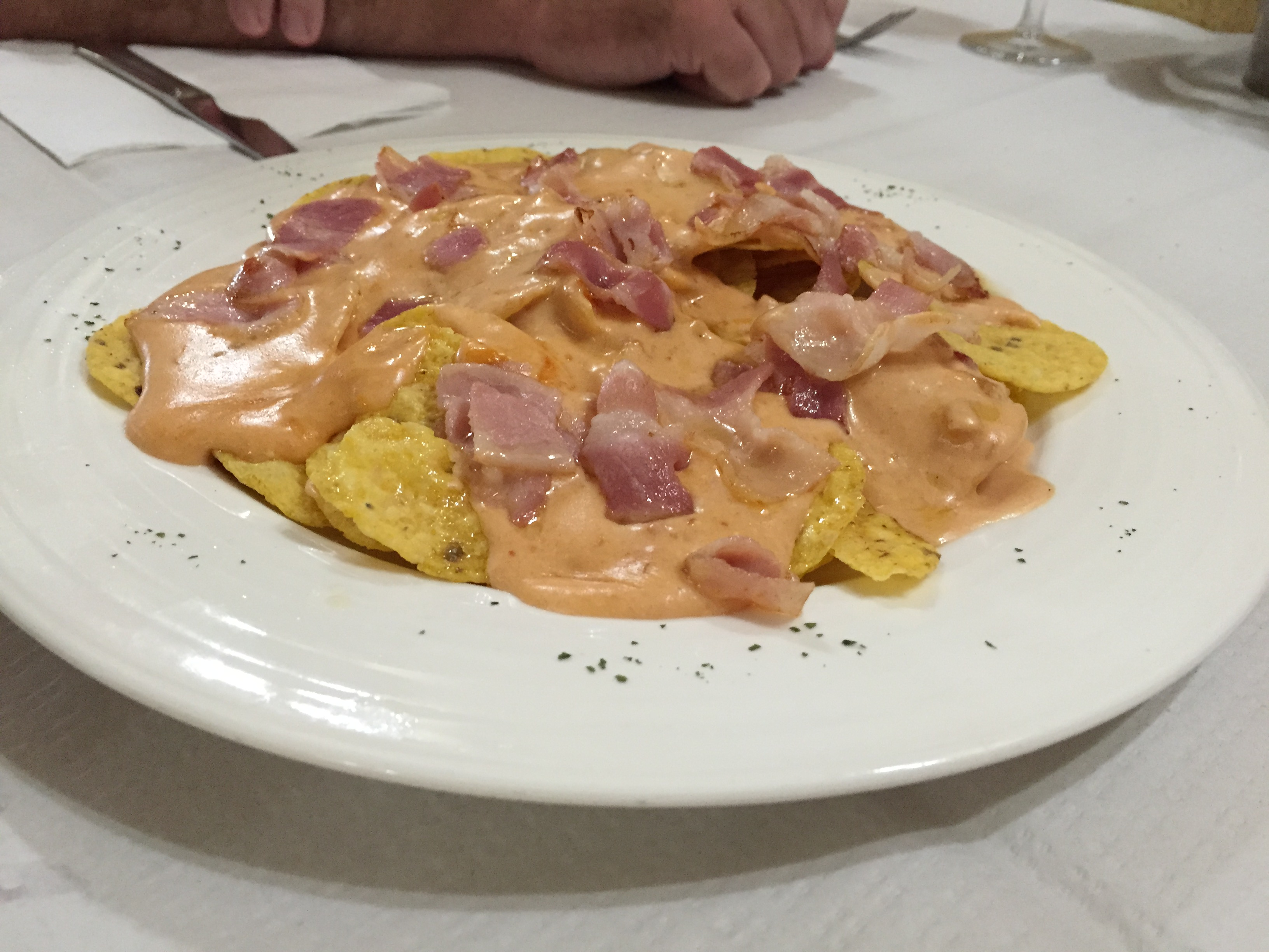 Nachos, the Spanish way with jamon of course.