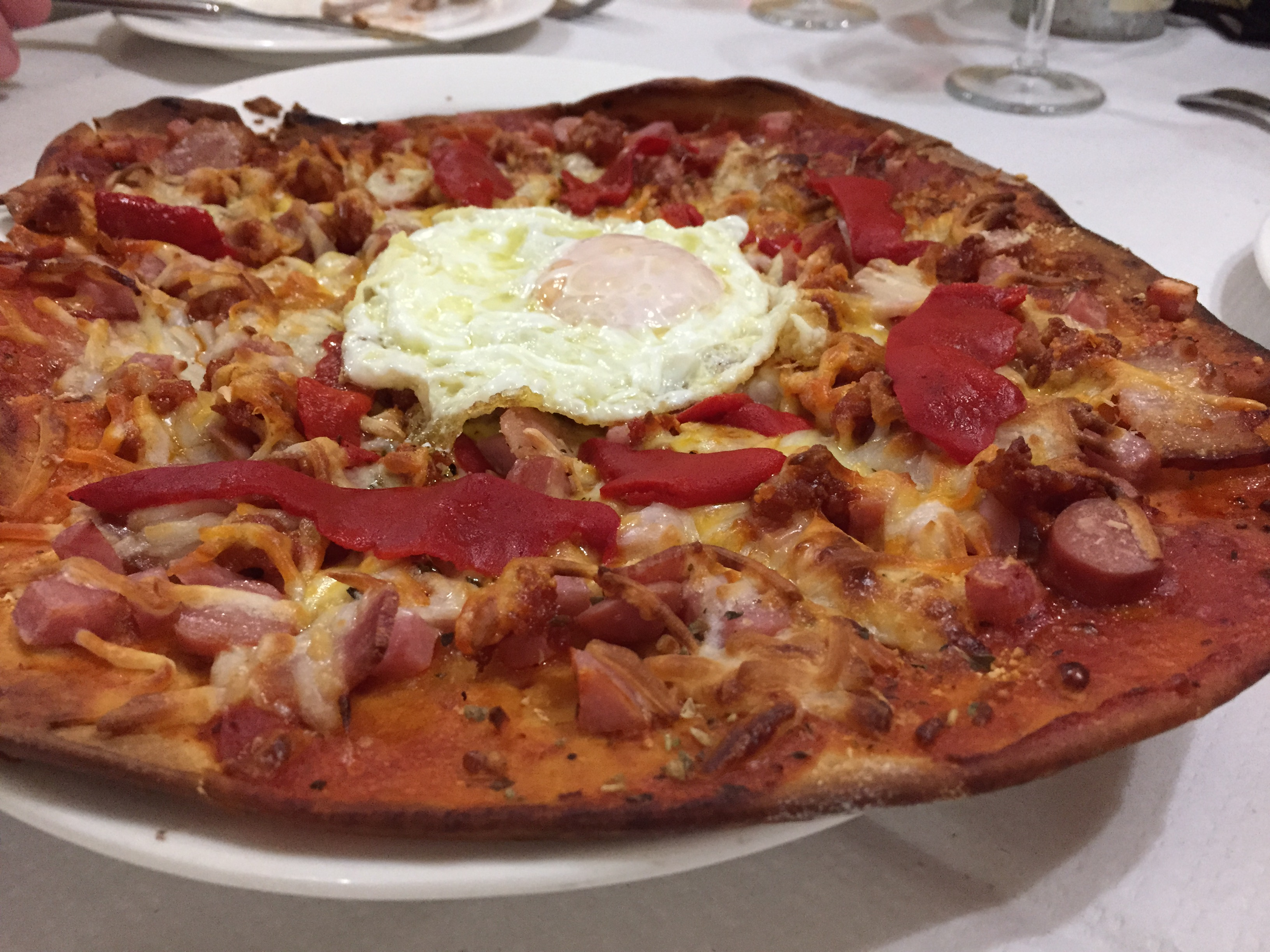 Spanish pizza, don't forget the egg!